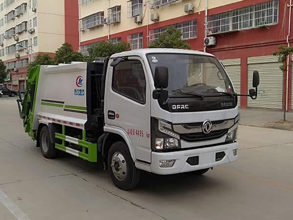 东风多利卡D6蓝牌压缩式垃圾车4方